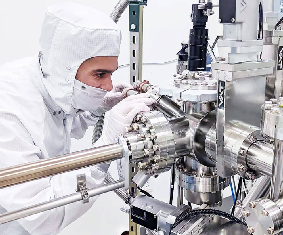 Sheaumann worker in cleanroom operating equipment
